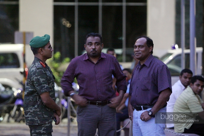 Former Defence Minister Tholhath Ibrahim (M), former Chief of Defence Force Major General Moosa Ali Jaleel (R) and former Male Area Commander Brigadier General Ibrahim Didi (L) consult as they look at mutinying police officers in the Republican Square hours before former President Mohamed Nasheed stepped down on February 7.